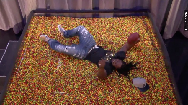 WATCH: Marshawn Lynch Dives into A giant Pool of skittles