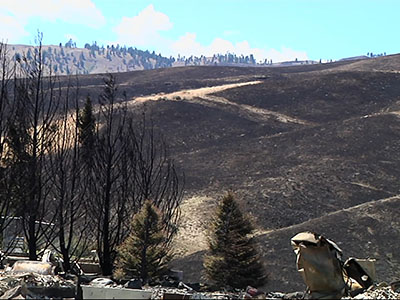 WA residents return to smoldering ruins