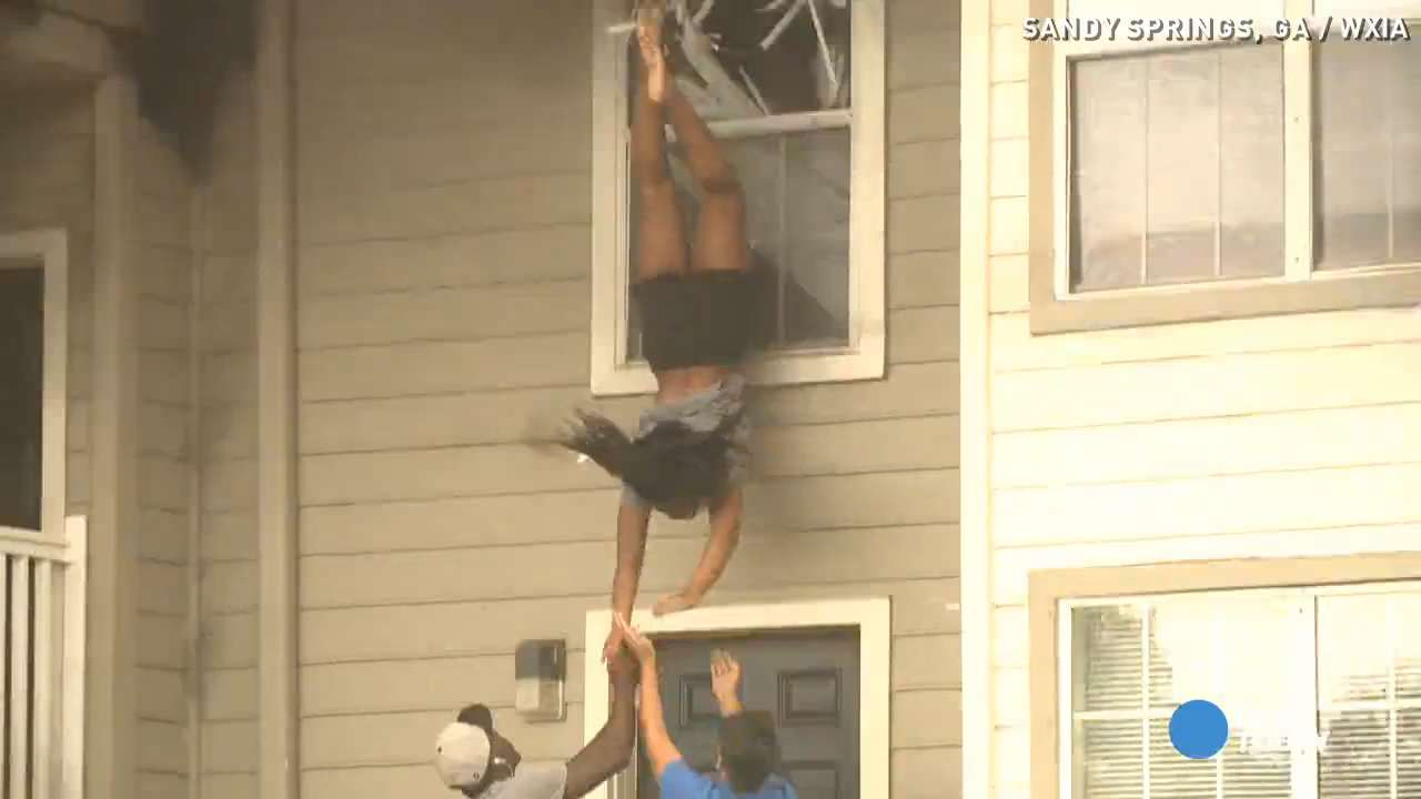 See girls dive out of window to escape massive fire