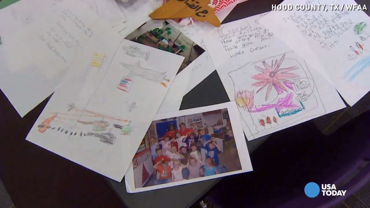 Students read letters they sent to Marine a decade ago
