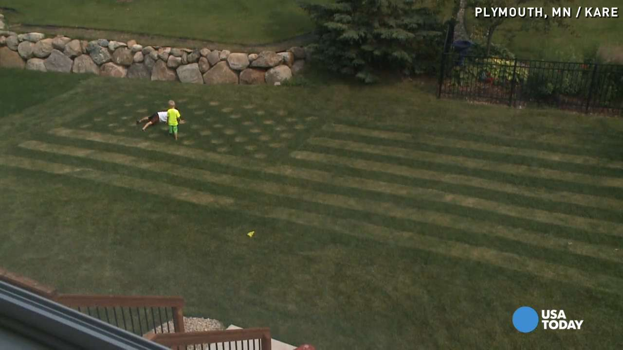 Man uses lawn mower to create massive American flag