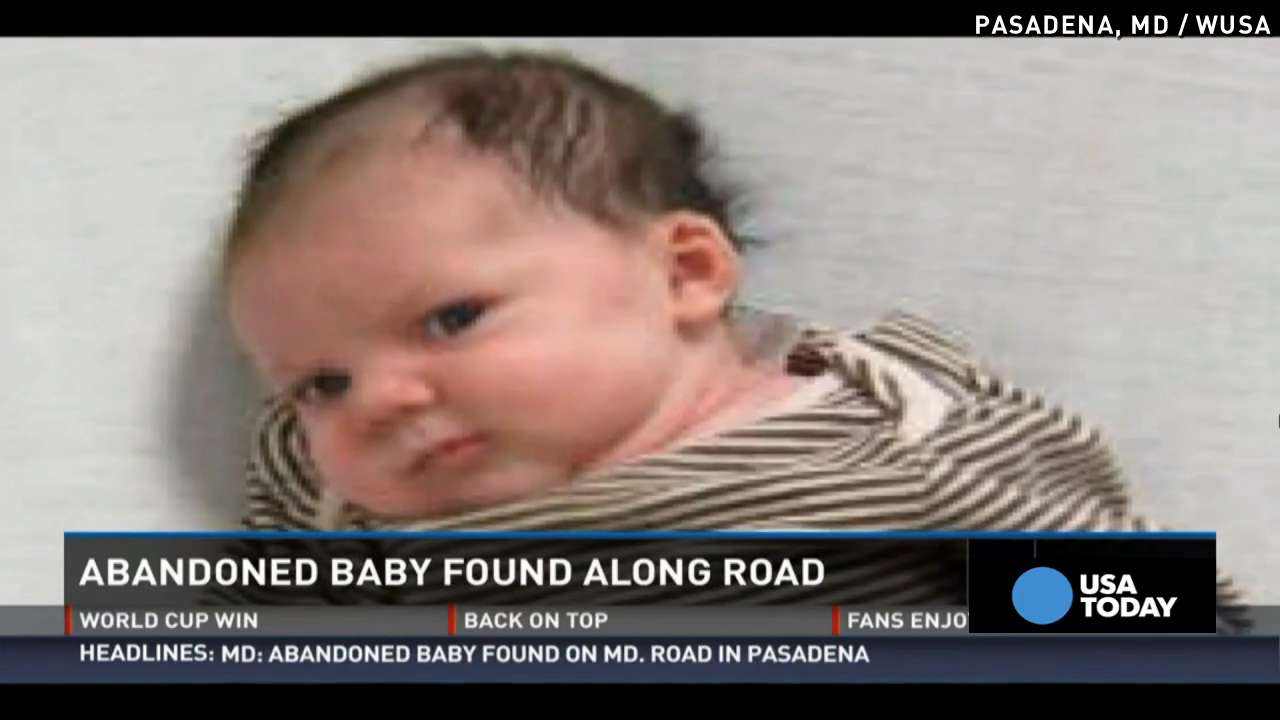 Mom charged after baby girl found on side of road