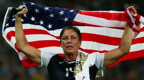 United States forward Abby Wambach hoists the FIFA World Cup trophy at 2015 Womens World Cup champions celebration at Microsoft Square at L.A. Live.