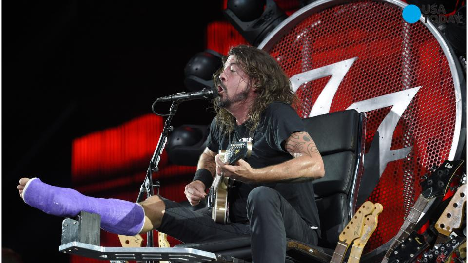 Dave Grohl performs weeks after breaking leg on top of throne