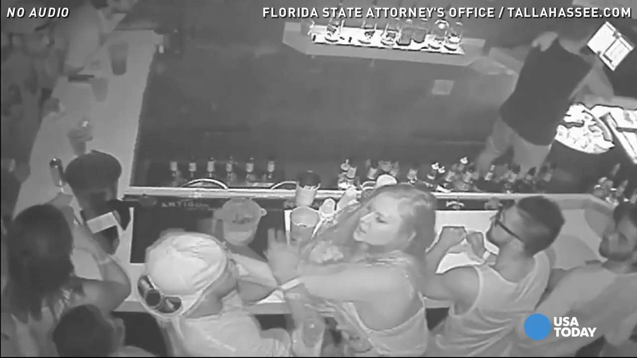 Surveillance video from a Tallahassee, Florida bar shows Florida State University quarterback De'Andre Johnson and a woman engaging in a bar fight in June 2015.