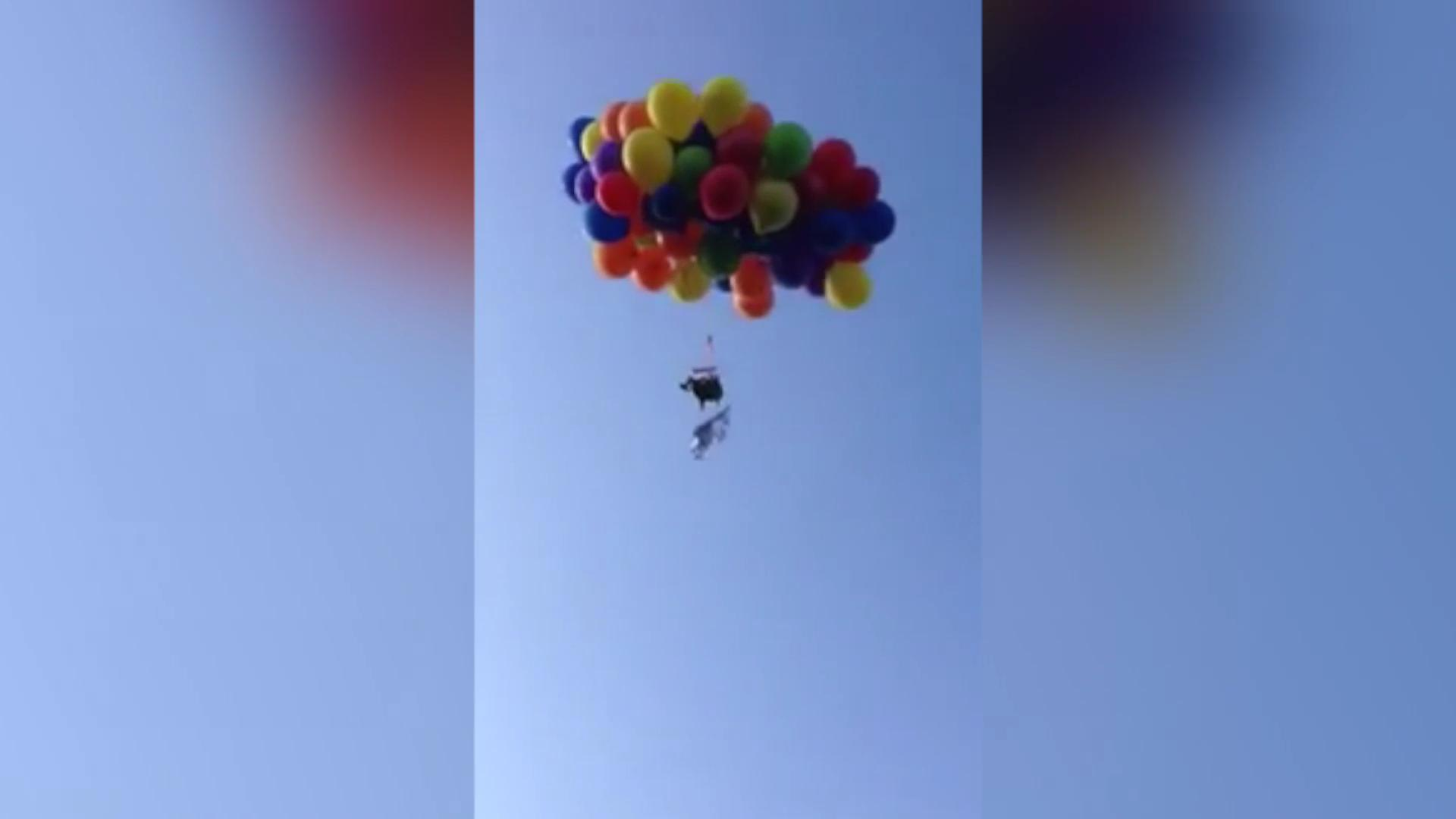 Man arrested for flying helium-balloon-assisted lawn chair over Canada