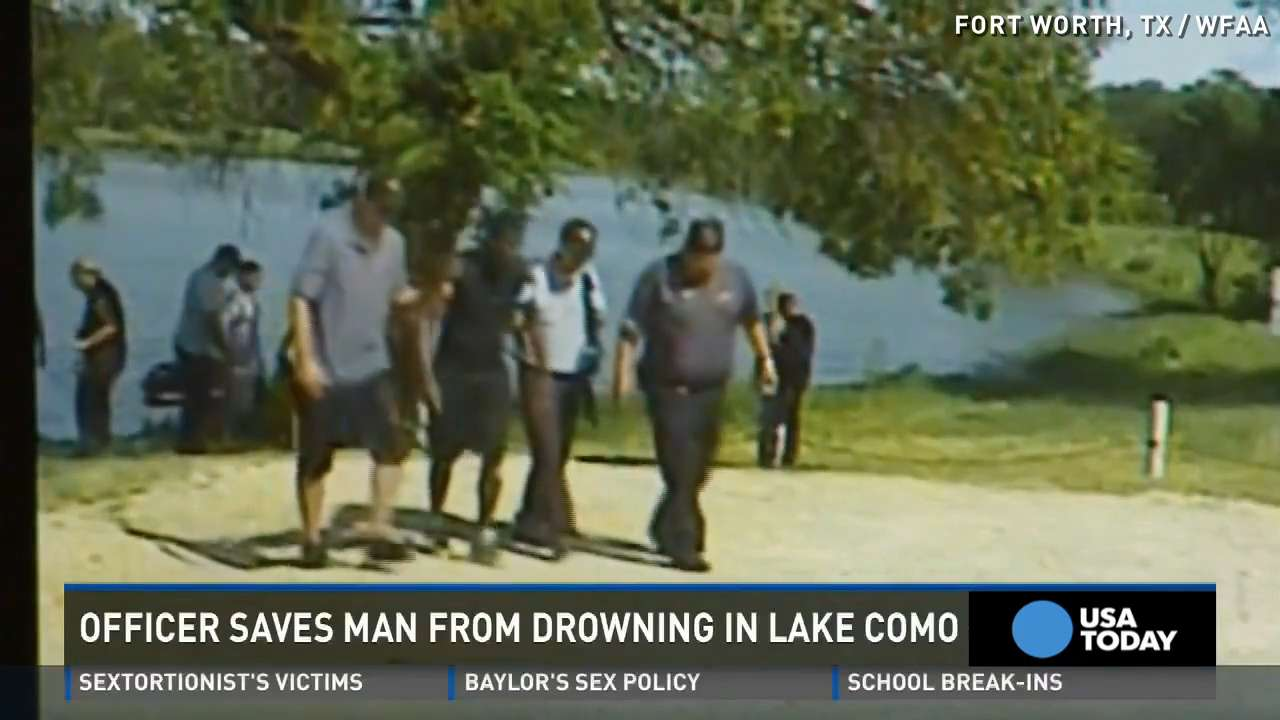 Watch cop jump in lake to rescue drowning man