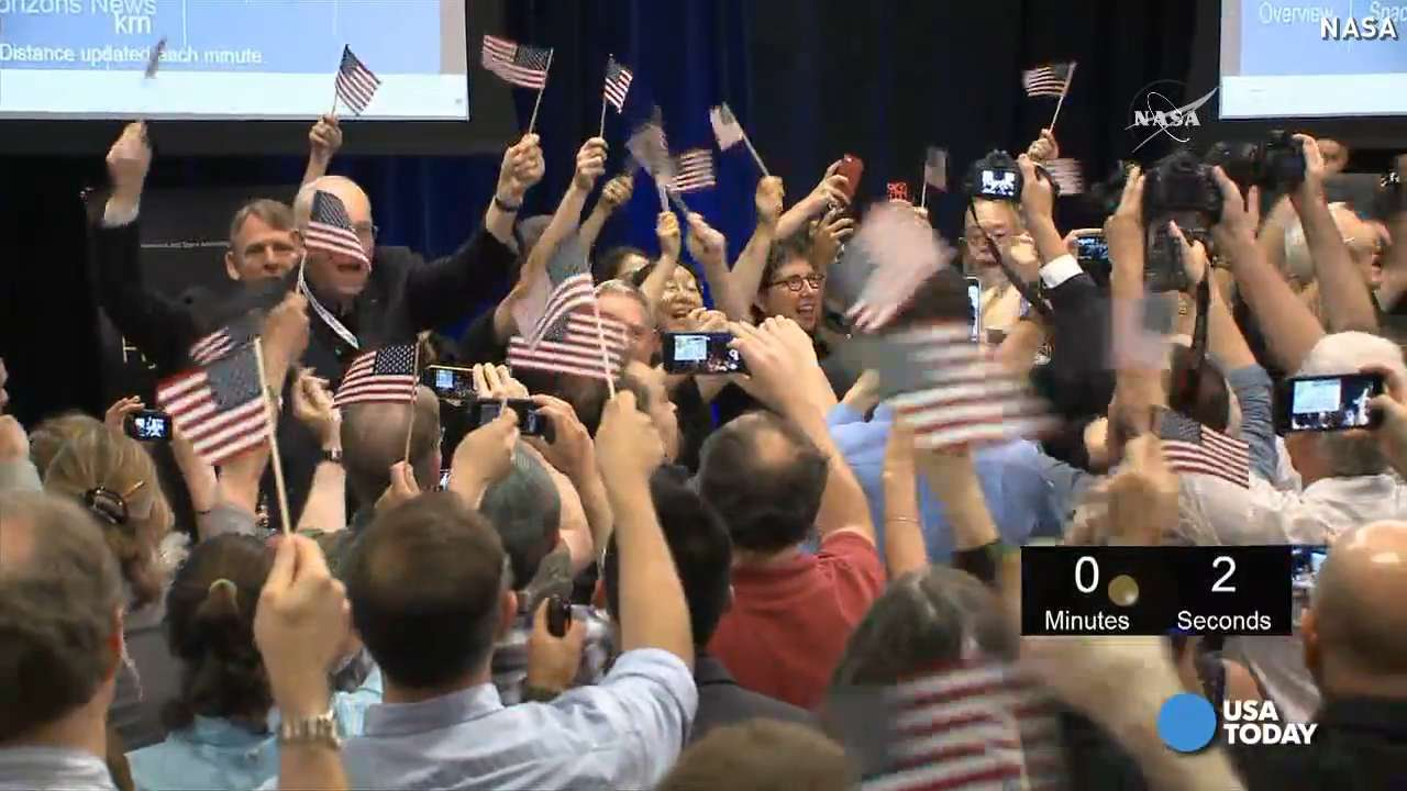 Pluto flyby elicits huge cheers, 'USA' chants at NASA