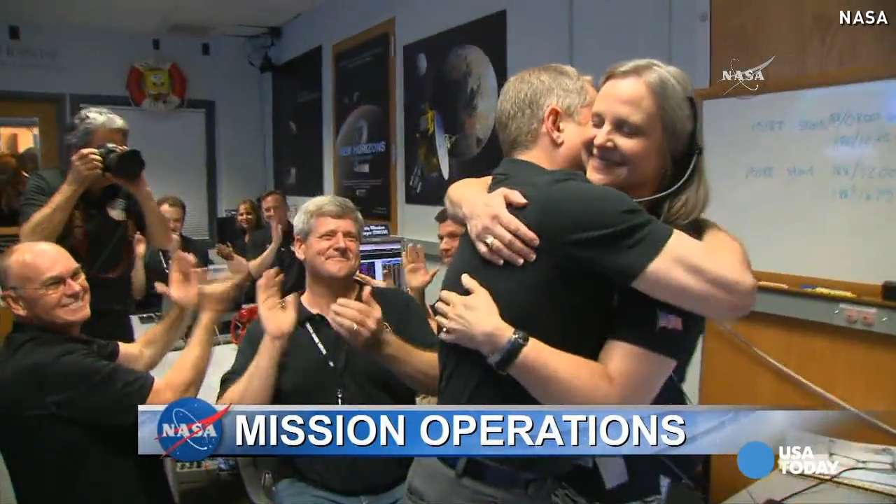 NASA celebrates after successful Pluto flyby