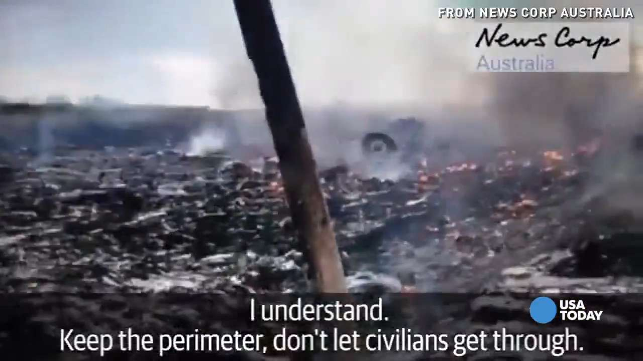 New video appears to show looting of MH17 crash site