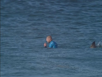 Surfer describes fighting off shark during competition