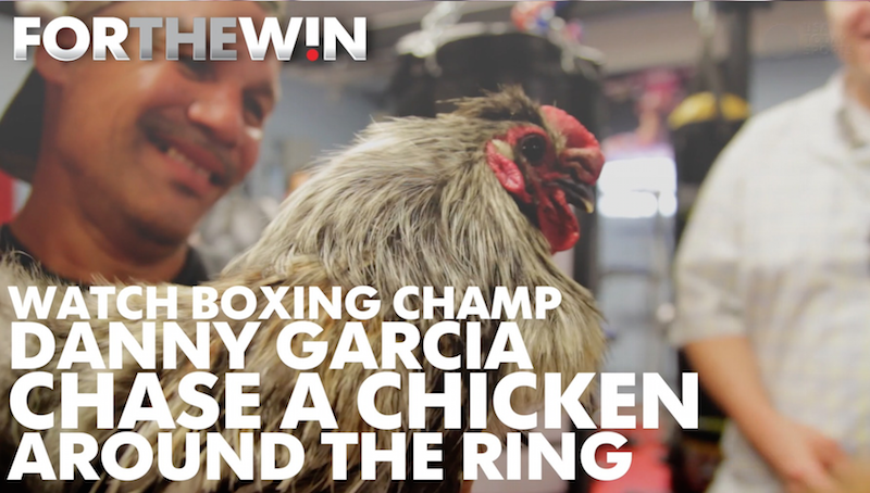 Watch boxing champ Danny Garcia chase a chicken around the ring