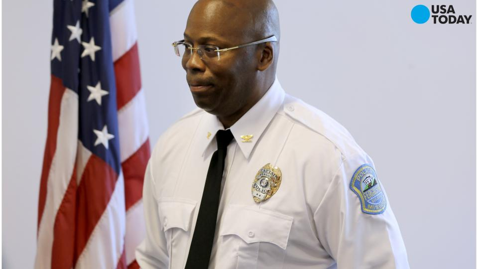 Ferguson hires black police commander as interim chief
