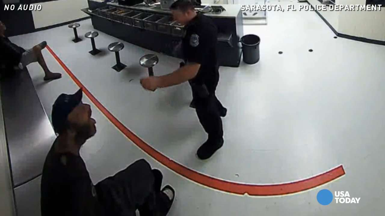 Video shows officer throwing peanuts at inmate