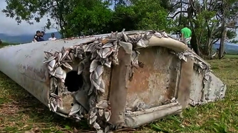 Investigators scramble to analyse wreckage for MH370 link