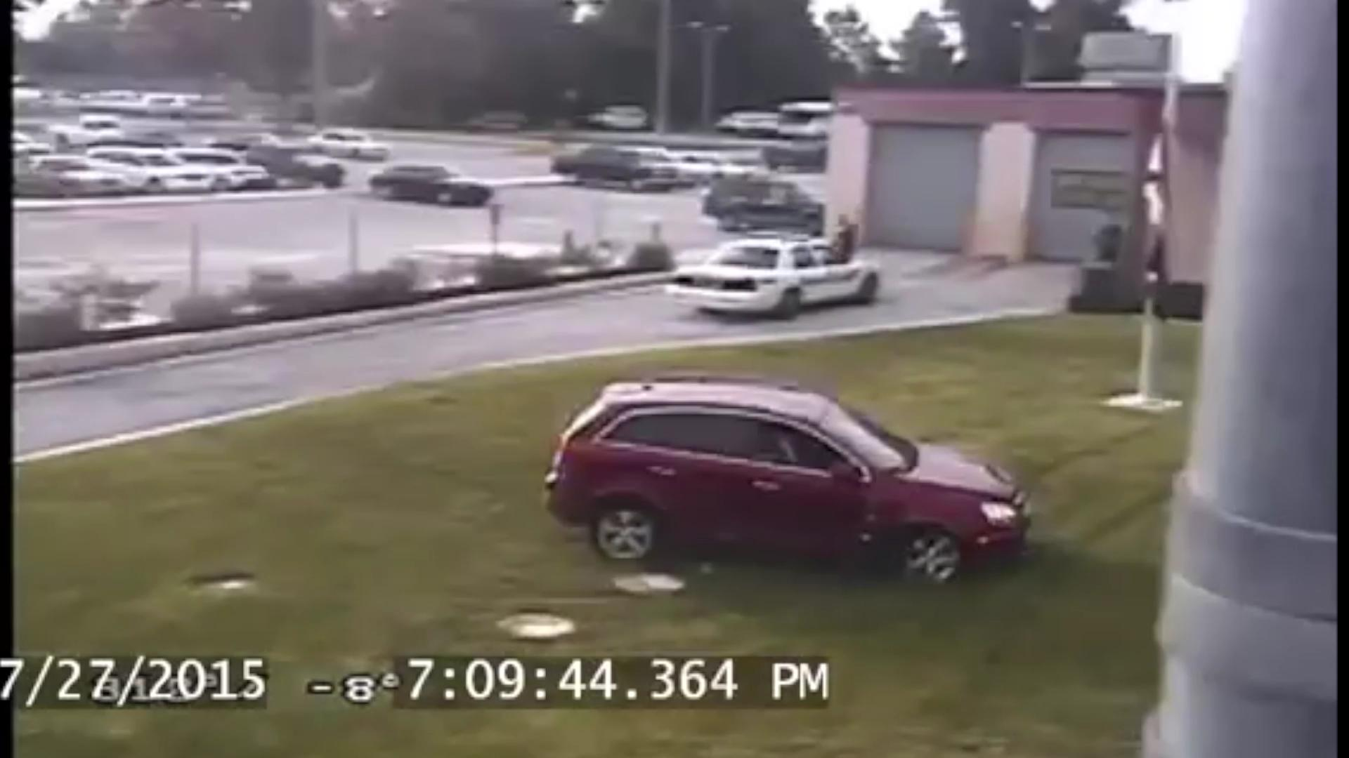 Man drives over jail lawn, crashes into flagpole, gets arrested