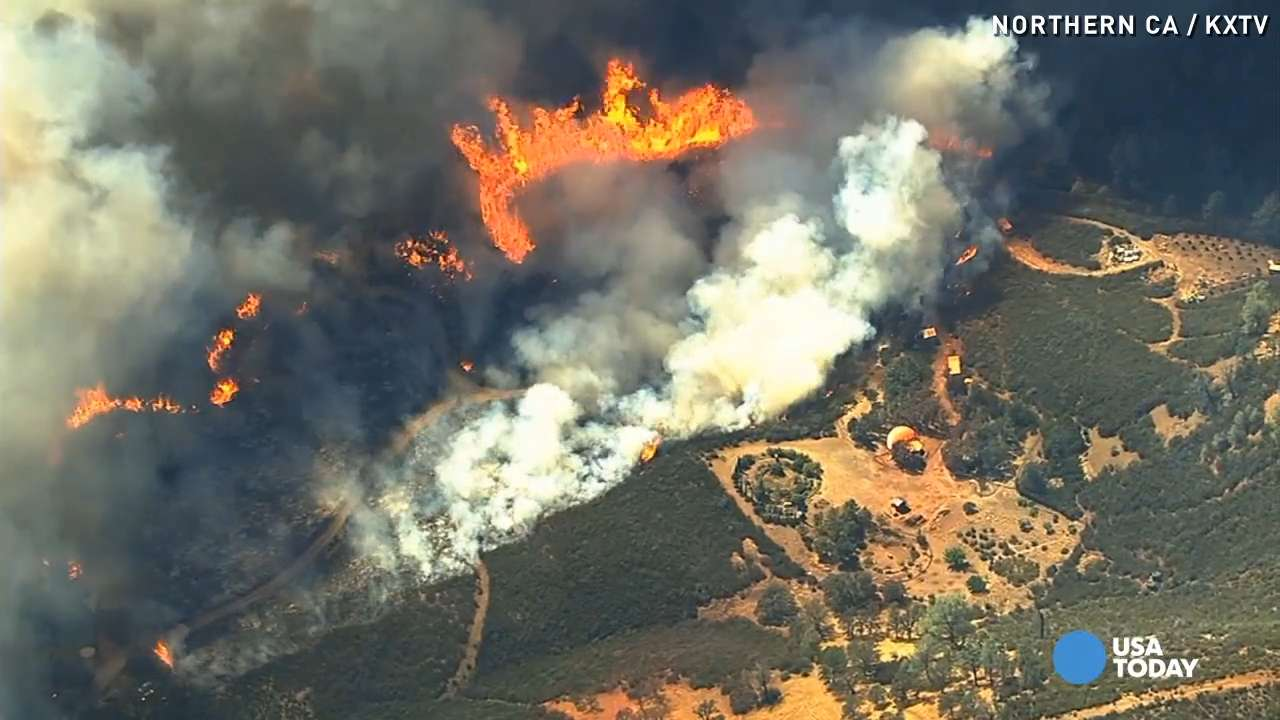 California wildfire jumps highway, quickly spreads
