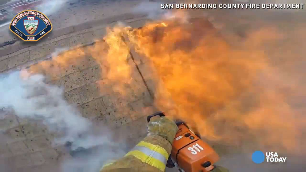 Watch firefighter dodge flames from burning home