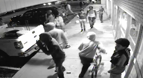 Ferguson surveillance video shows possible gunman