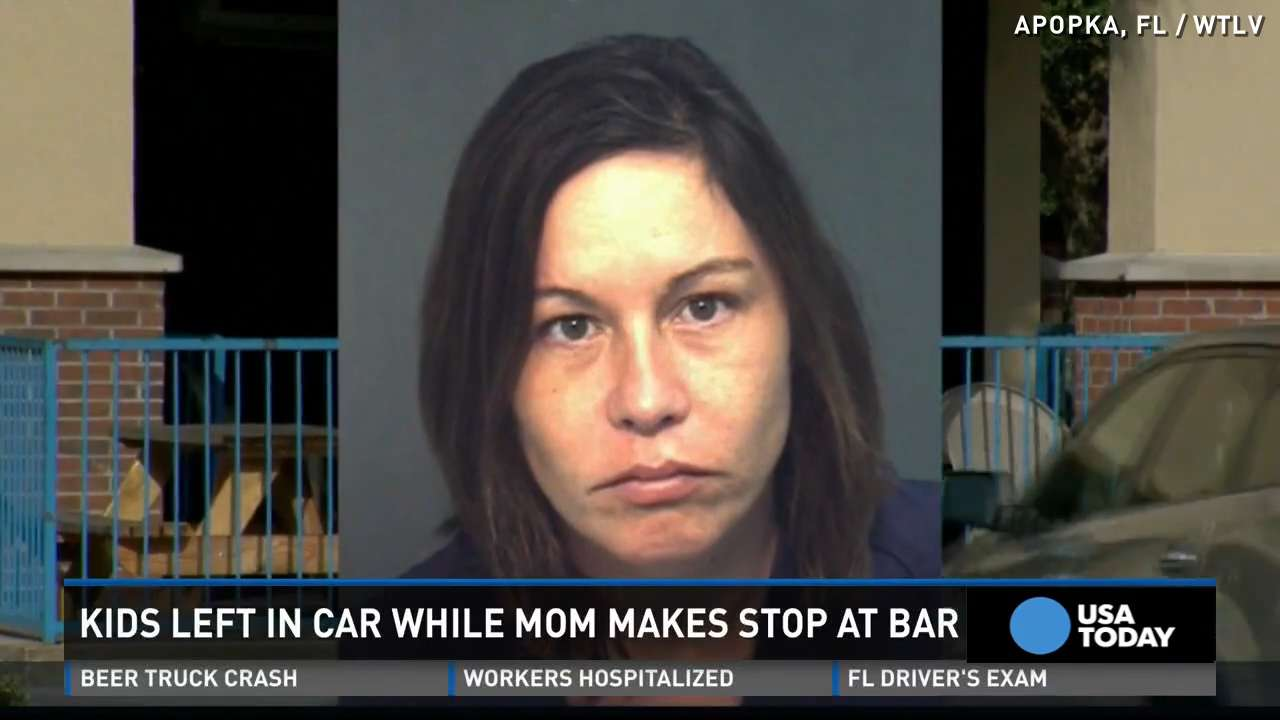 Police: Mom leaves kids in hot car to drink at a bar