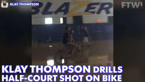 Klay Thompson drills half-court shot on bike
