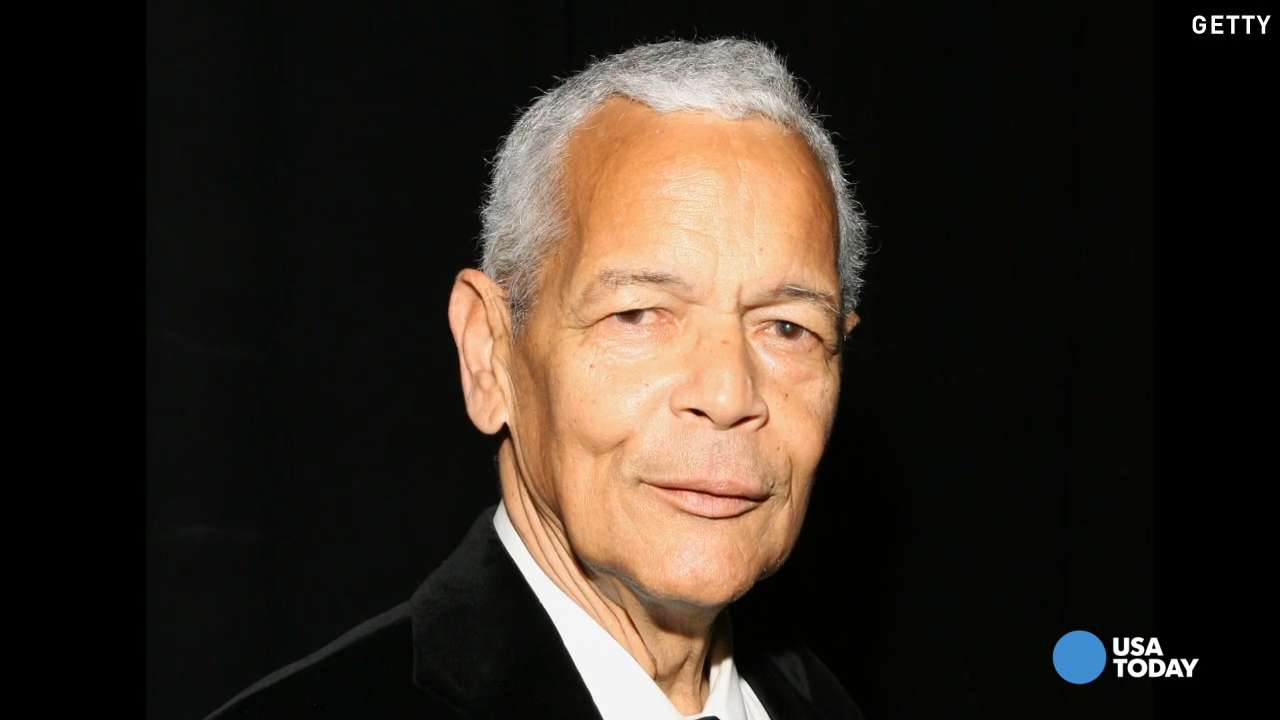 Julian Bond walks through the streets of Philadelphia during the NAACP convention in July 2015.