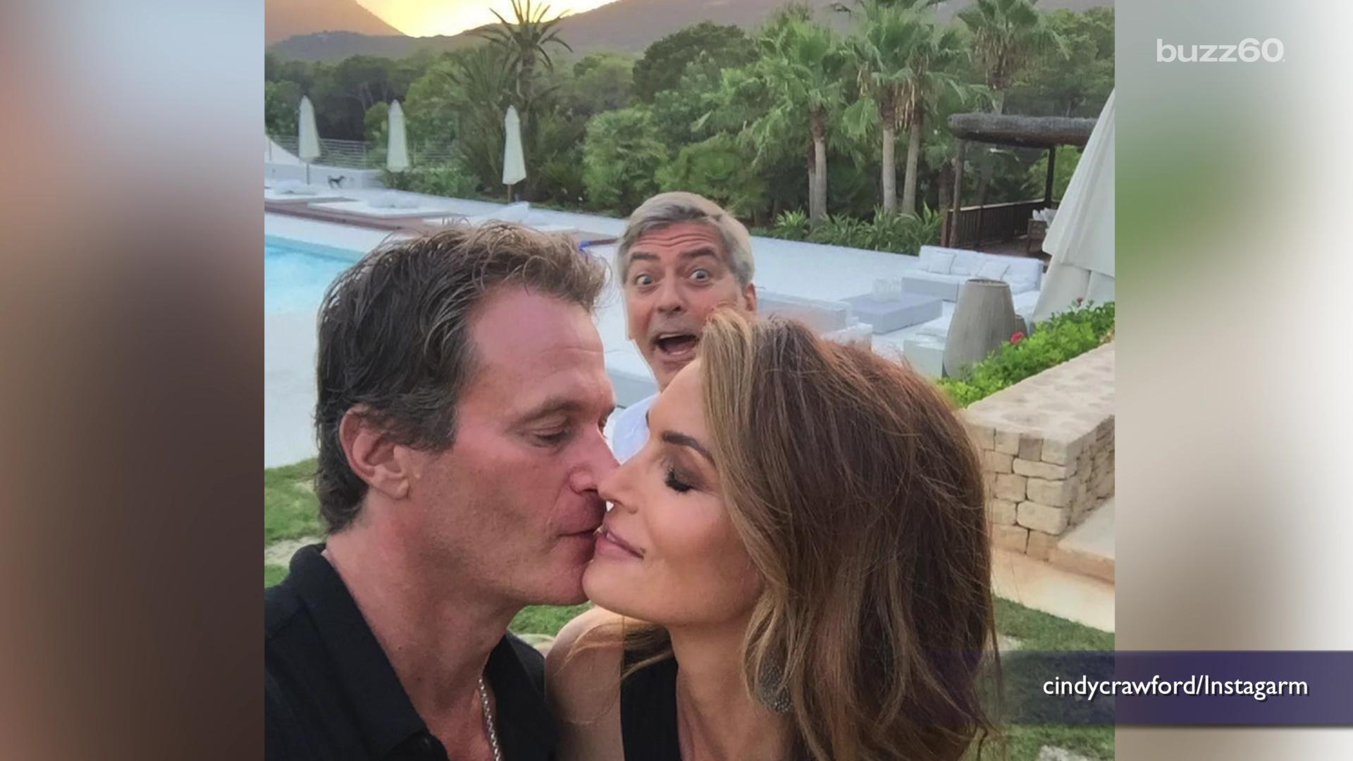 George Clooney photobombs Cindy Crawford