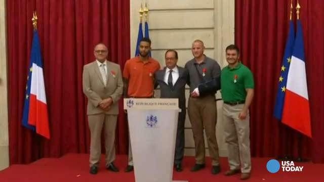 Men who stopped train attacker receive France's highest honor