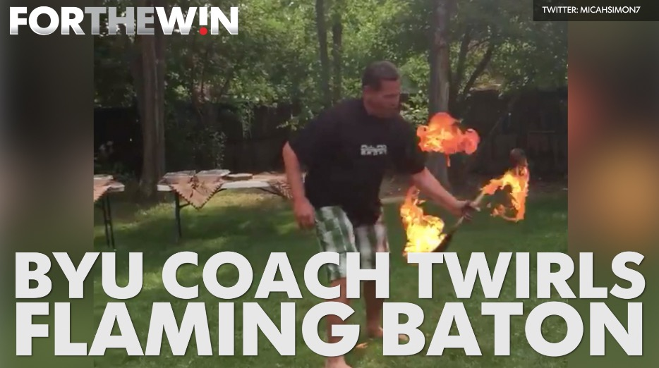 BYU coach twirls flaming baton