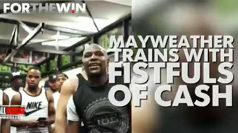 Floyd Mayweather trains with fistfuls of cash