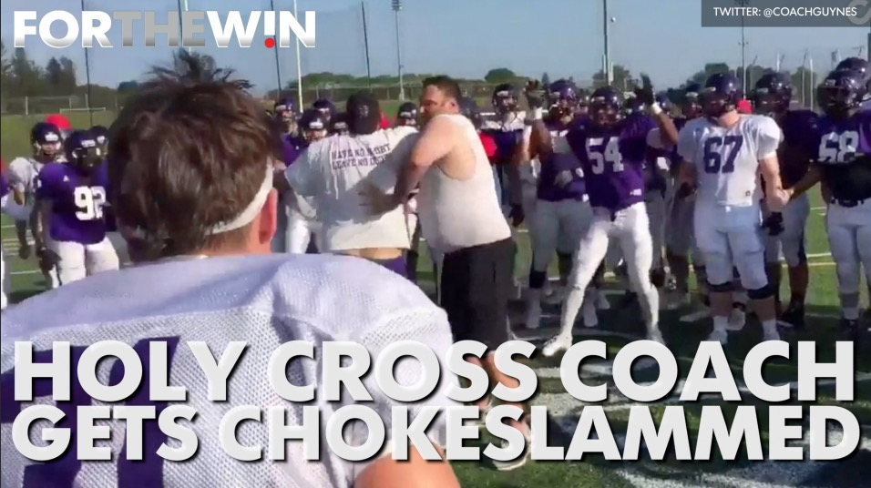 Holy Cross coach gets chokeslammed
