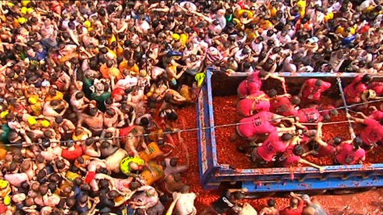 Tomatina battle paints the Spanish town of Bunol in red