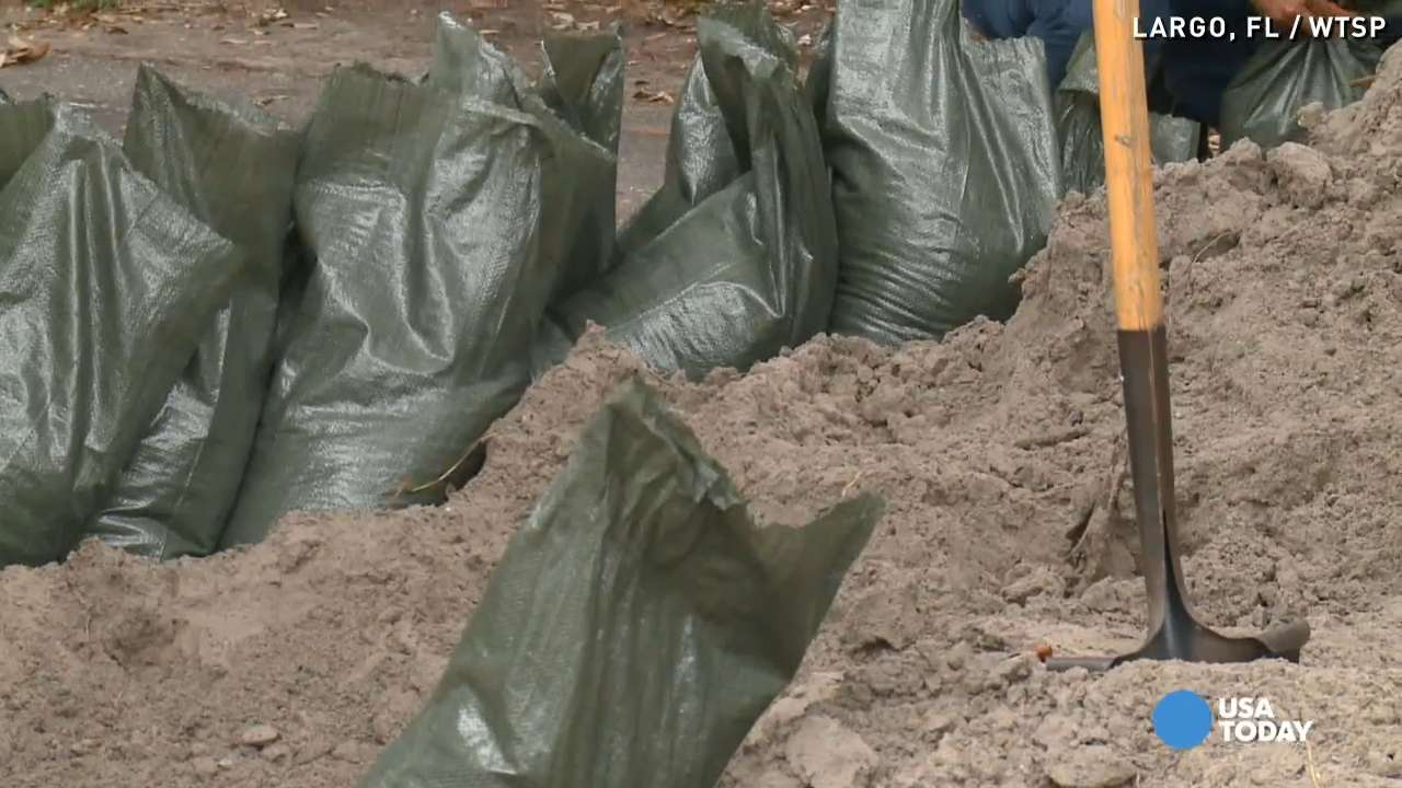 Florida residents brace for soaking from Erika remnants