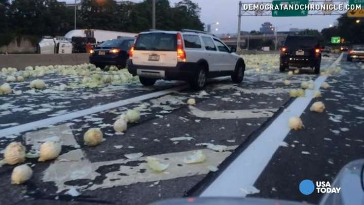 Cabbage tossed everywhere after truck rolls over