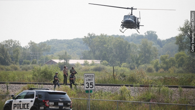 Illinois officer shot dead; police search for 3 suspects