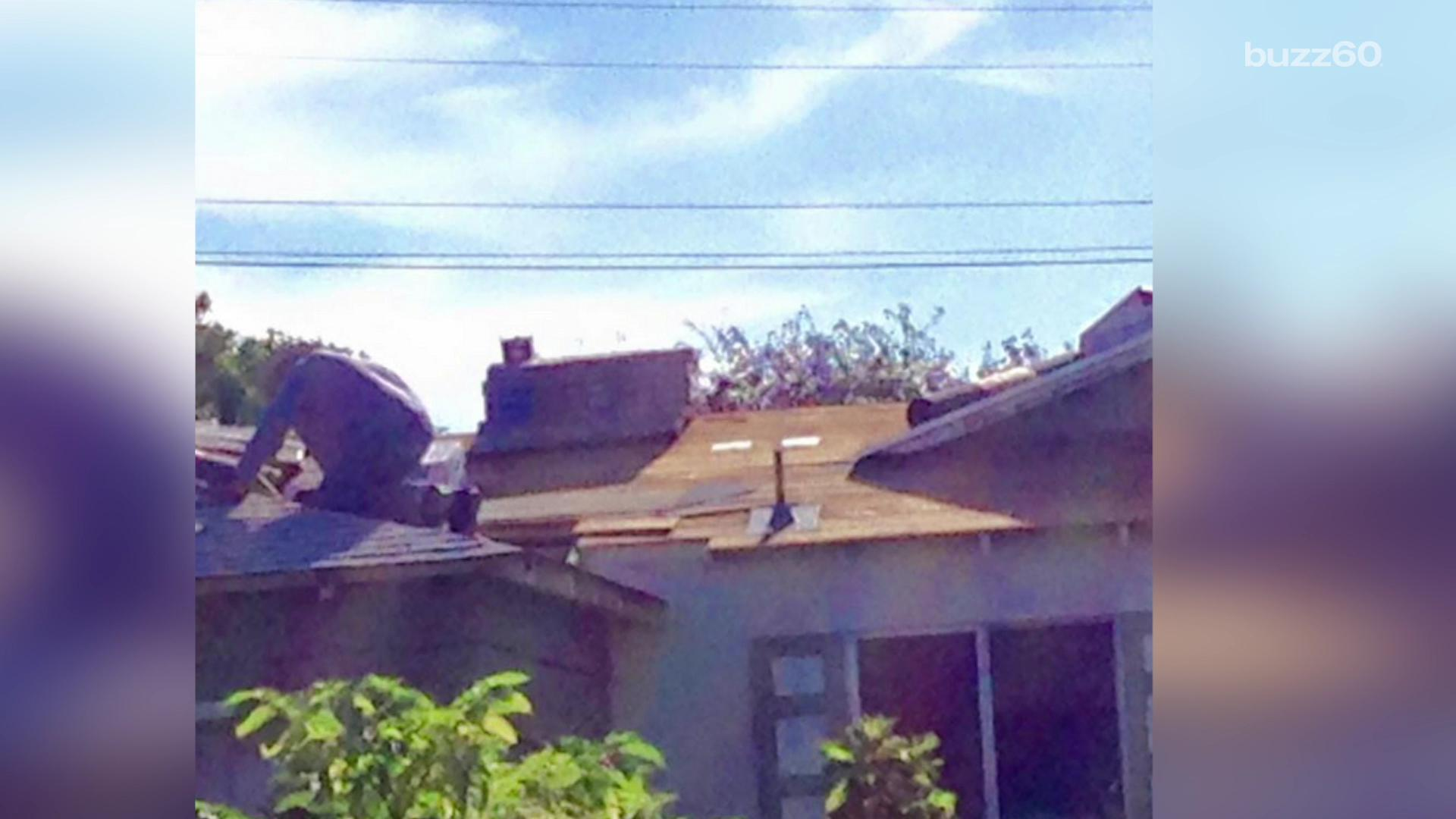Strangers gather to fix man's roof after neighbor's Facebook plea