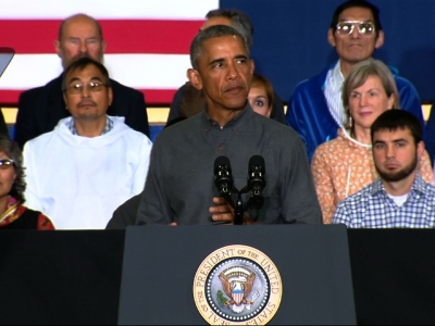 Obama warns of climate change impact in Alaska