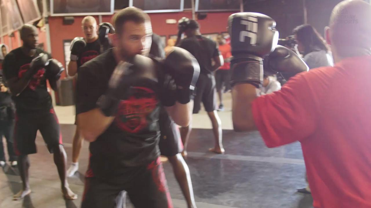 UFC fighters join forces to give Detroit Pistons a pre-season workout to remember