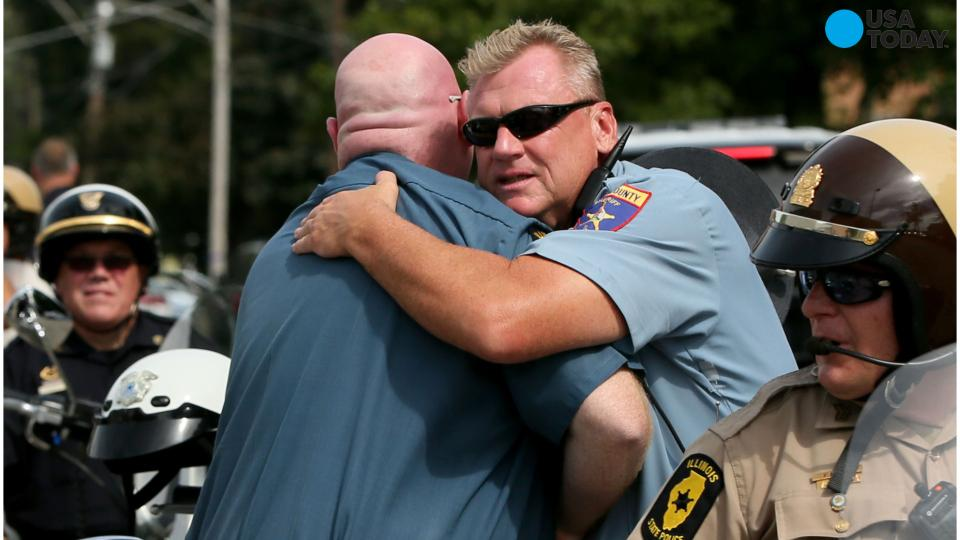 Illinois town mourns officer as manhunt for killers continues
