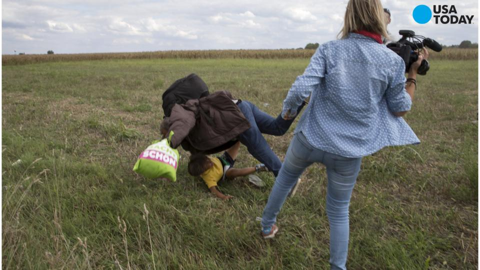 TV camerawoman fired after kicking, tripping migrants