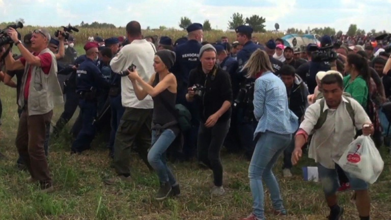 Hungarian TV camerawoman fired for kicking fleeing migrants