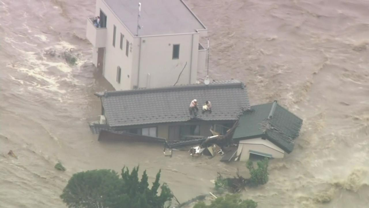 Floods in Japan strand people on rooftops