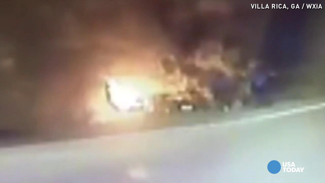 Car bursts into flames, officers save driver inside
