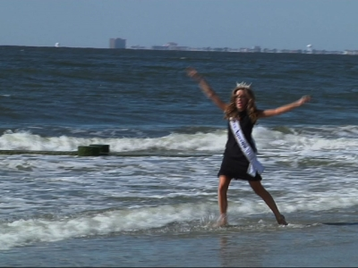 Miss America frolics in the Atlantic City surf