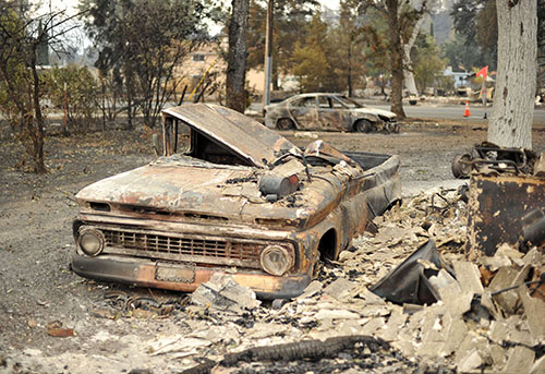 Fire keeps burning in wiped-out Calif. town