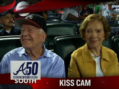 Jimmy Carter and wife share a smooch on 'Kiss Cam'