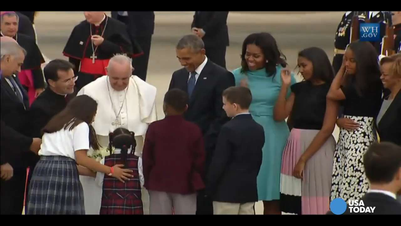 Pope Francis greeted by Obama family after landing