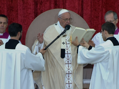 Pope Francis Tackles Issues, Embraces Crowds