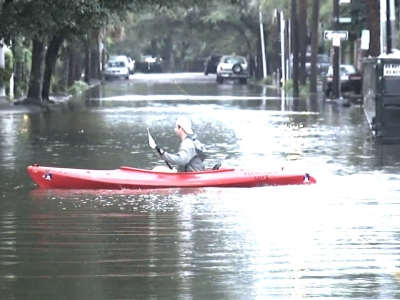 Kayakers paddle down flooded Charleston, South Carolina streets