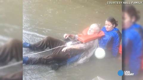 Strangers rescue man and dog trapped in car by flood